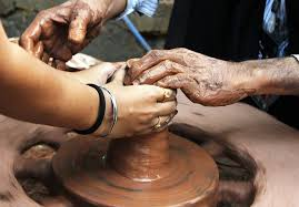 Throwing clay on the potters wheel